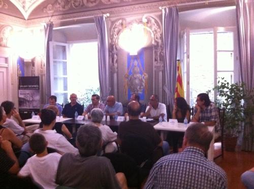 Conferència a Darnius, un any després de l'incendi